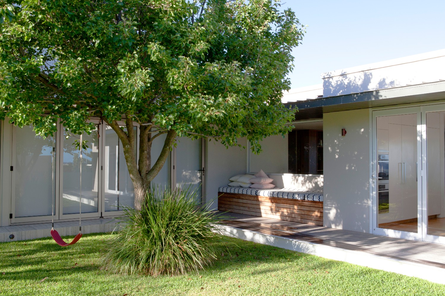 house in Cottesloe with swing and day bed lawn and garden maintenance